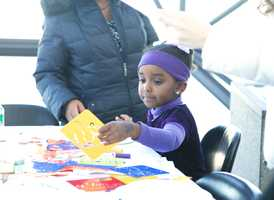 """Makeda Daniel, 4, is designing her china. """"Today is very kids' friendly, compared to other days, and teaches the kids history that I don't know. They can see and experience in person,"""" said Makeda's mother, an Ethiopian immigrant who has brought her son and daughter to the museum more then ten times."""