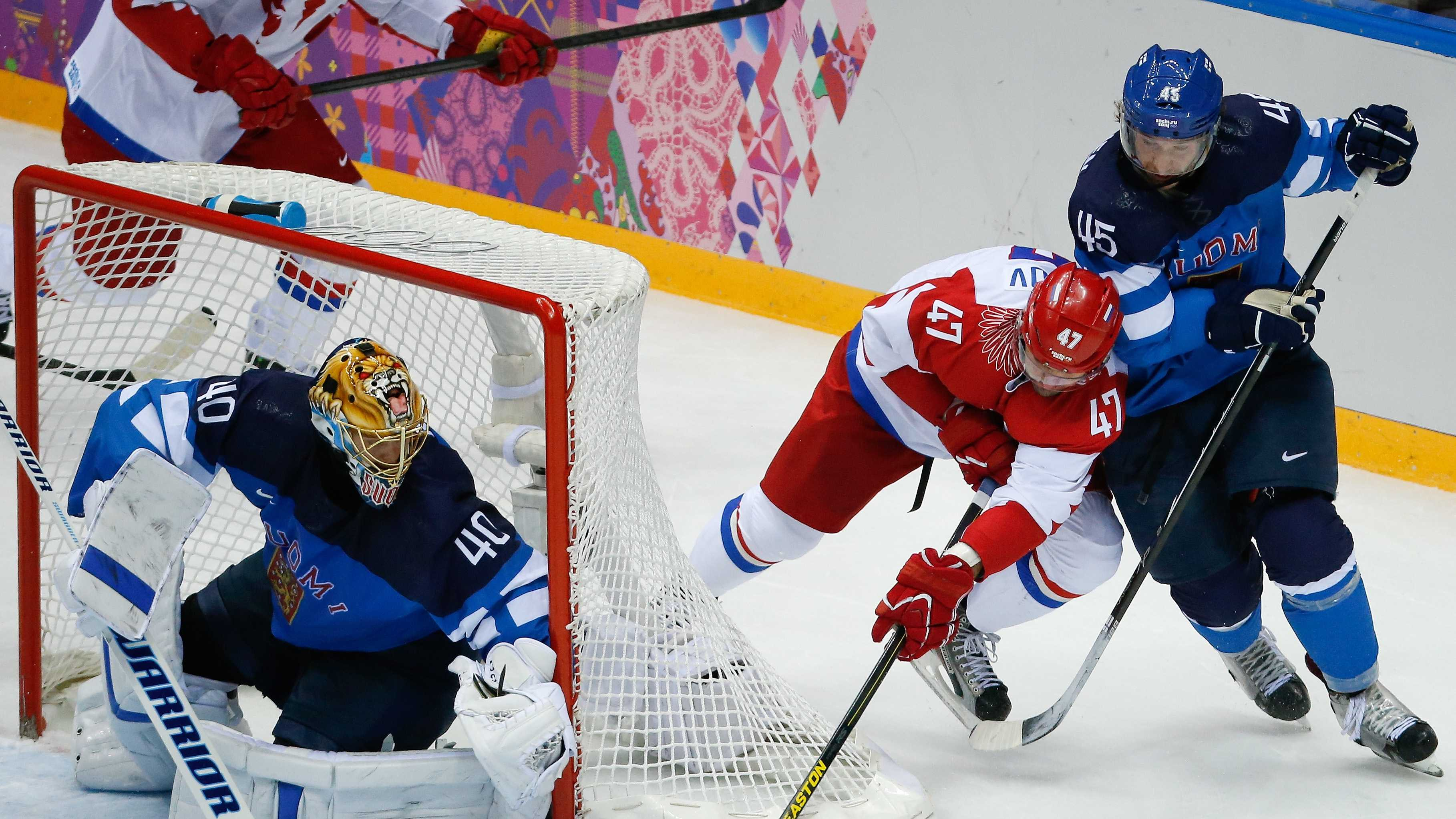 Russia forward Alexander Radulov tries to score against Finland defenseman Sami Vatanen and Finland goaltender Tuukka Rask in the second period of a men's quarterfinal ice hockey game at the 2014 Winter Olympics, Wednesday, Feb. 19, 2014, in Sochi, Russia.