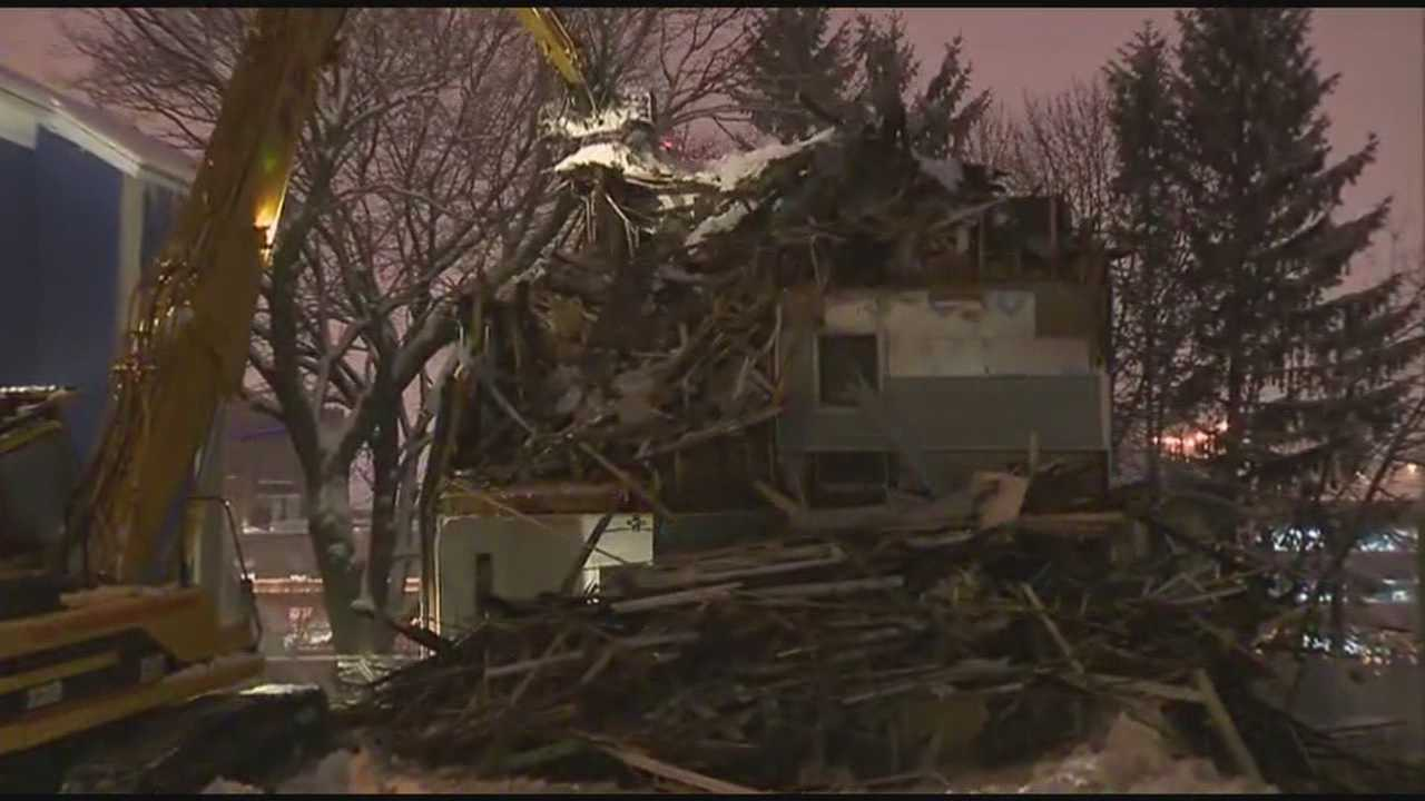A triple-decker home in the city of Worcester that appeared to be in danger of collapsing was torn down Wednesday evening.