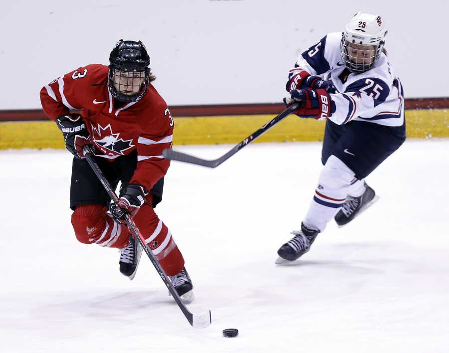 Alex Carpenter, of North Reading, Mass., is on the women's ice hockey team. Carpenter (right) also played for Boston College. Her father is former NHL player Bobby Carpenter.