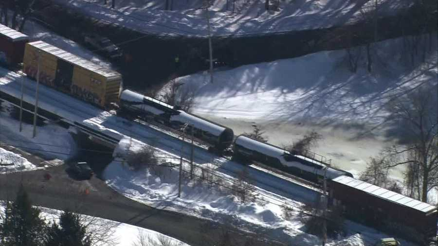 Two of the train cars are carrying liquefied petroleum gas, according to the Westford town manager.