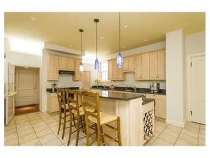 The kitchen has granite counters and a Subzero fridge.