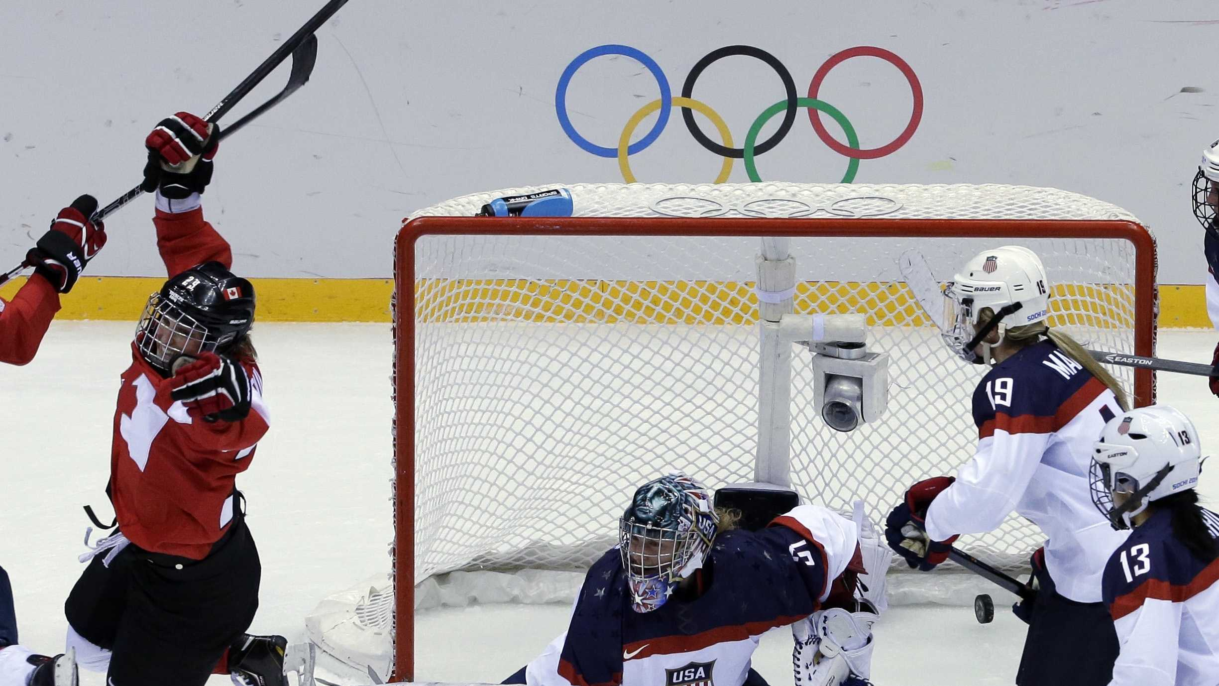 Marie-Philip Poulin of Canada (29) reacts after scoring past USA goalkeeper Jessie Vetter (31) of the women's gold medal ice hockey game at the 2014 Winter Olympics, Thursday, Feb. 20, 2014, in Sochi, Russia.