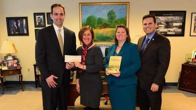 Michael Richards (left) recently donated $1,500 to a local charity, as payment for a long-overdue library book. Also in the photo are Housing Families Community Outreach Coordinator Patty Kelly, Malden Public Library Director Dora St. Martin, Mayor Gary Christenson COURTESY PHOTO