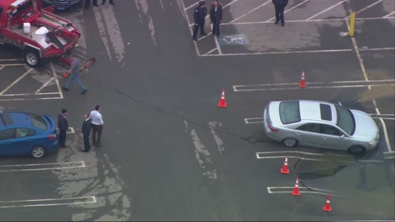 Sinkhole nearly swallows car in mall parking lot