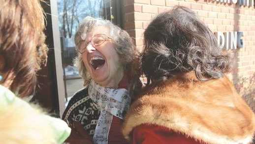 Helen Fisher is overjoyed as she meets her nieces, Barbara Garro of Saratoga Springs, N.Y., and Jean Carl of Exton, Pa., for the first time at the McGann Terrace Community Center in Fairhaven.