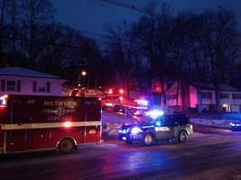 Two people have died in a fire in Methuen early Wednesday morning, and surrounding homes are being evacuated.
