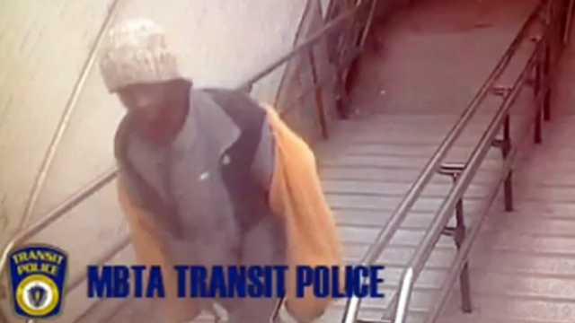 MBTA Police are looking for the man who was wearing a black and orange jacket and white hat seen on surveillance cameras before they say he harassed a child on a train.