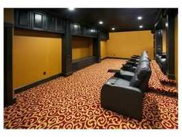 Finished lower level includes home theater & play room