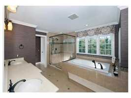 The home has 4 full and 4 partial bathrooms.