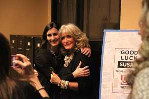 Susan gets a hug from news producer Lisa Simmons.