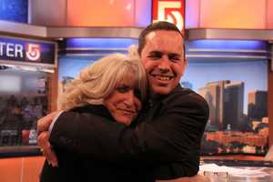 News Director Andrew Vrees gets a big hug from Susan before her final newscast.