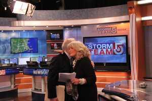 A hug from WCVB-TV President Bill Fine
