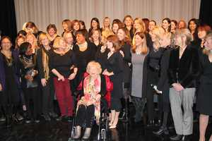 The women of WCVB-TV gather with Susan for a farewell photo.