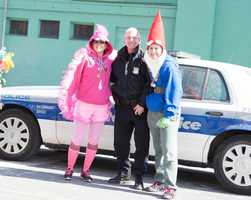 A police officer asks to be photographed with two participants.