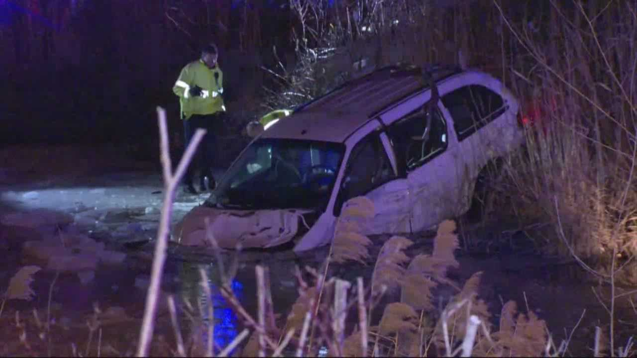 A crash sent a minivan into the water and four people to a local hospital Saturday night, Milford police said.