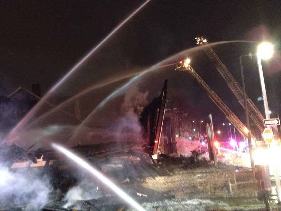 The fire has been knocked down, but crews were continuing to douse hotspots with water. Some nearby buildings were damaged.