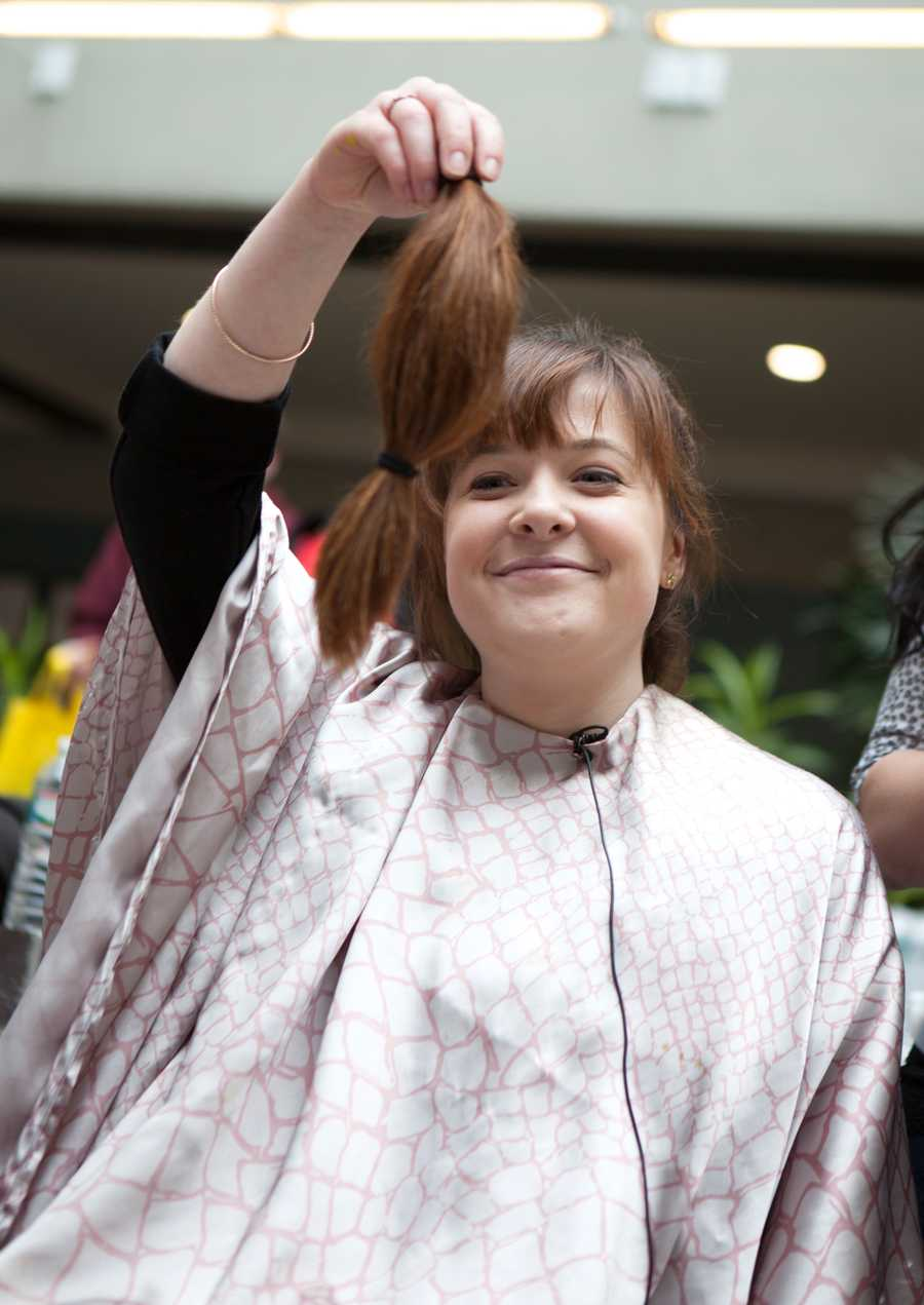 """""""I need to figure out how to tell my mom,"""" said Jenny-Lynn Cone, an employee of Granite Telecommunications, a Quincy company. Cone is one of the 400 employees who shaved their heads or beards and raised more than $2 million for the Dana-Farber Cancer Institute."""