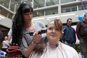 """I see a lot of beautiful people and beautiful hearts here,"" said Tara Smigliani (left), a hairdresser from Dorchester. ""It's a amazing to be part of it."" She volunteered to help."