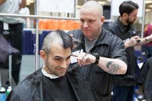 There are more male employees than female employees in the company getting their hair shaved.