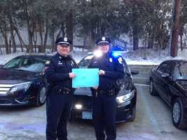 Two Bedford, Mass., police officers prepare to depart for Rhode Island.