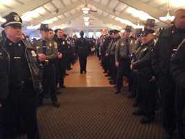 Law enforcement officers wait to greet Tyler.