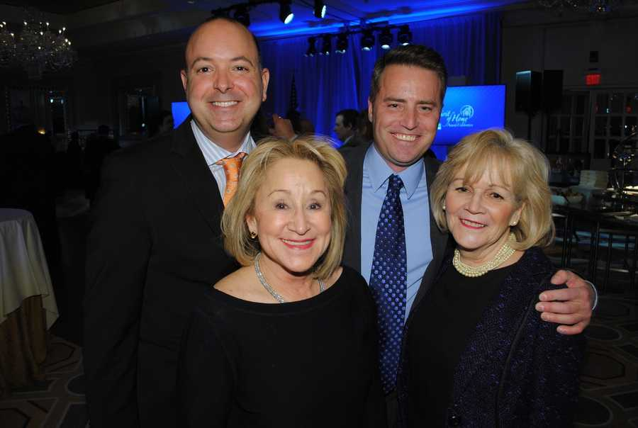 Ed Feijo, Brian Long with Gail Roberts and Margo Delaney, all of Coldwell Banker Residential Brokerage in Cambridge