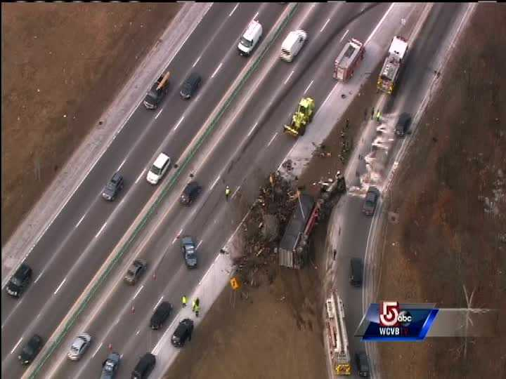 A load of scrap metal spilled onto the roadway.