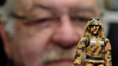Ron Rudat of Attleboro was among the artists at Hasbro in Pawtucket who helped create the new Cobra line of G.I. Joe figures in the 1980s. The action figure turns 50 this month. Rudat holds a G.I. Joe figure that was named Dusty, after Rudat.