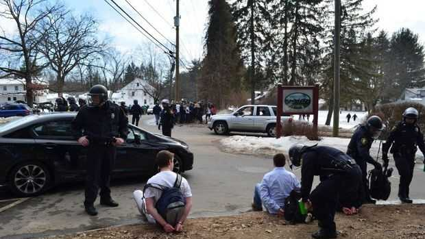 Police officers from Amherst, UMass and the Massachusetts State Police donned in full riot gear moved in on a crowd of what appeared to be several thousand University of Massachusetts Amherst students celebrating the annual Blarney Blowout party in the area of several large apartment complexes off Meadow Street in North Amherst shortly after noon on Saturday, March 8, 2014.