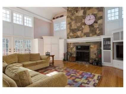 The great room has afloor-to-ceiling fireplace.
