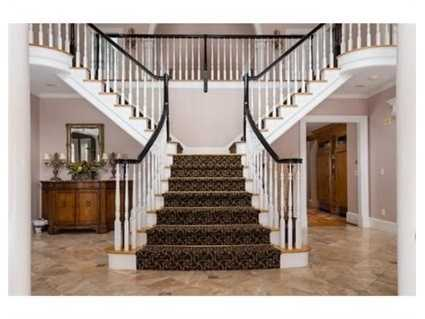 The 5 bedroom main home has an open floor plan with architectural barreled ceilings.