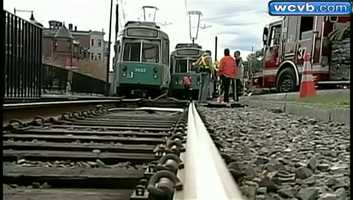 An MBTA trolley operator and two passengers were hurt.
