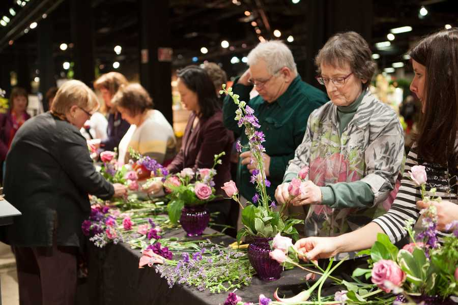 "Visitors learn to arrange flowers together. There are other lectures like ""Sustainable Lawn Care"" and ""Master Food Preserver"" available."