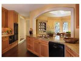 Spectacular gourmet kitchen with adjoining informal dining room with fireplace, abundant natural light and stellar views.