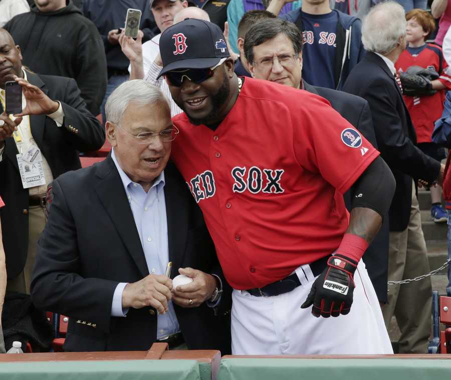 Boston Mayor Tom Menino, left, prepares to throw out the ceremonial first pitch beside Boston Red Sox designated hitter David Ortiz, right, before Game 1 of baseball's American League division series between the Sox and the Tampa Bay Rays, Friday, Oct. 4, 2013, in Boston.