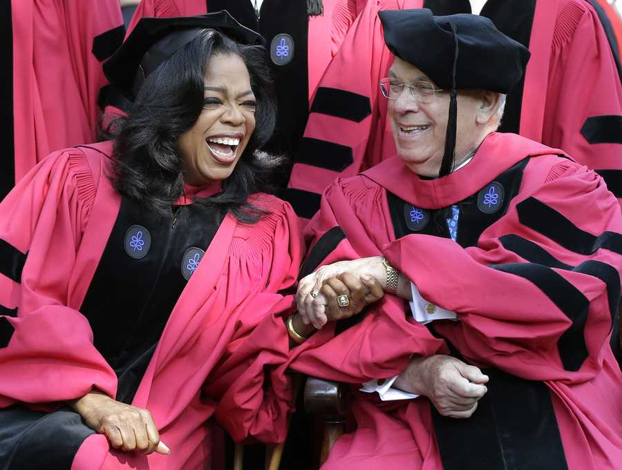 Oprah Winfrey clasps hands with Boston Mayor Thomas Menino prior to their receiving honorary degrees from Harvard University at commencement ceremonies in Cambridge, Mass., Thursday, May 30, 2013.