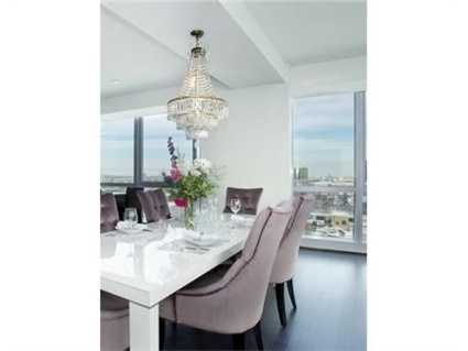 The dining room has floor to ceiling windows.