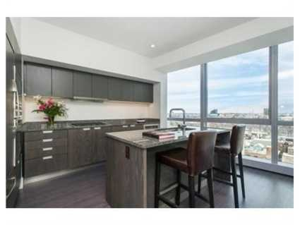 Exquisite Chef's kitchen with granite counters and top of the line appliances.
