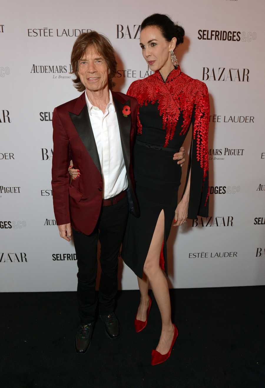 L'Wren Scott was a fashion designer and celebrity stylist who was Mick Jagger's girlfriend. The Utah-born Scott had her own fashion label popular with celebrities. She was a fixture on Jagger's arm and, at around 6-foot-3, towered over her famous boyfriend.  She founded her high-end label in 2006 and recently created a more affordable line of clothes with Banana Republic.
