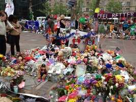 Stuffed animals and other items left at the Copley Square Memorial for the 2013 Boston Marathon.