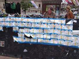 Messages of support on notes and boards at the Copley Square Memorial for the 2013 Boston Marathon.