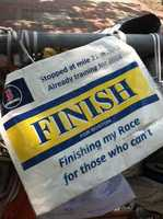 """This is one of a series of photos I took on the last day of the Copley Square memorial site for the Boston Marathon bombings. This photo features a running bib that says """"Stopped at mile 21 in 2013/Already training for 2014. Finishing my Race for those who can't."""""""