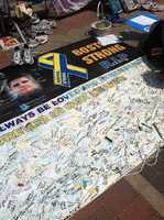 This is one of a series of photos I took on the last day of the Copley Square memorial site for the Boston Marathon bombings. This banner featured signatures and messages from visitors across the world. The memorial featured a collection of well-wishes and messages of sympathy, hope, and strength. It was taken down on June 25, 2013, and its contents will be archived in a more permanent location.