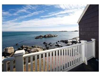 This property's vistas are a unique treasure to behold day and night, with a sunny southeasterly exposure, beautiful sunrises, and views overlooking the twinkling lights of Tinker's Island, open ocean and Boston's skyline