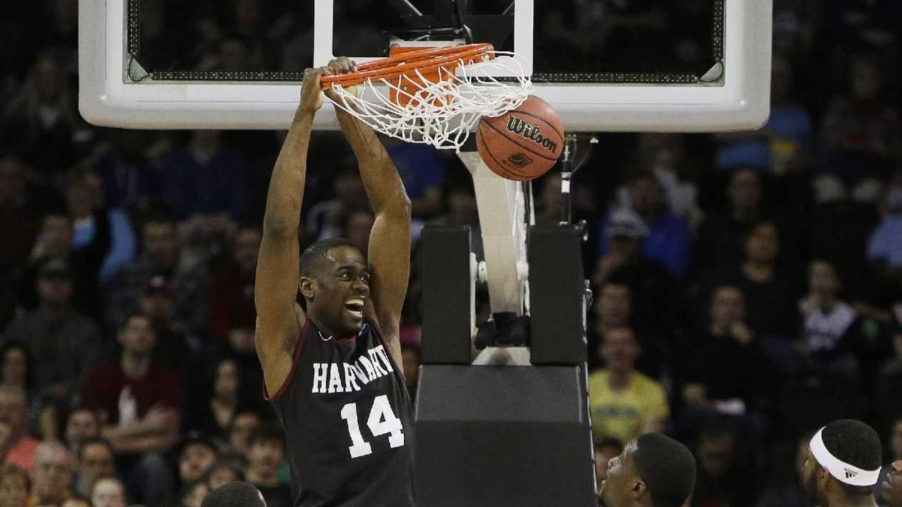 Harvard's Steve Moundou-Missi (14) dunks against Cincinnati in the second half during the second-round of the NCAA men's college basketball tournament in Spokane, Wash., Thursday, March 20, 2014.