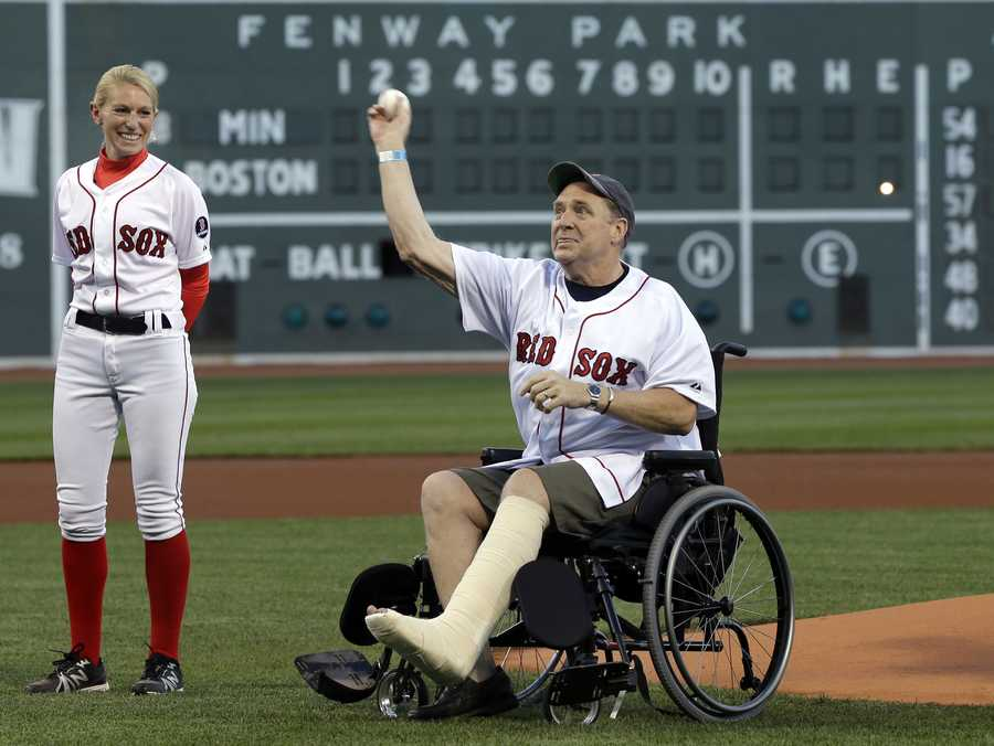 Boston Marathon bombing victim Ron Brassard of Epsom, N.H., throws out a ceremonial first pitch prior to a baseball game between the Boston Red Sox and the Minnesota Twins at Fenway Park in Boston, Tuesday, May 7, 2013.