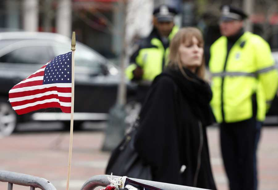 A small flag flies on a memorial in Copley Square on Boylston Street in Boston, Wednesday, April 24, 2013. Businesses opened and traffic was allowed to flow all the way down Boylston Street on Wednesday morning for the first time since two explosions at the Boston Marathon on April 15.