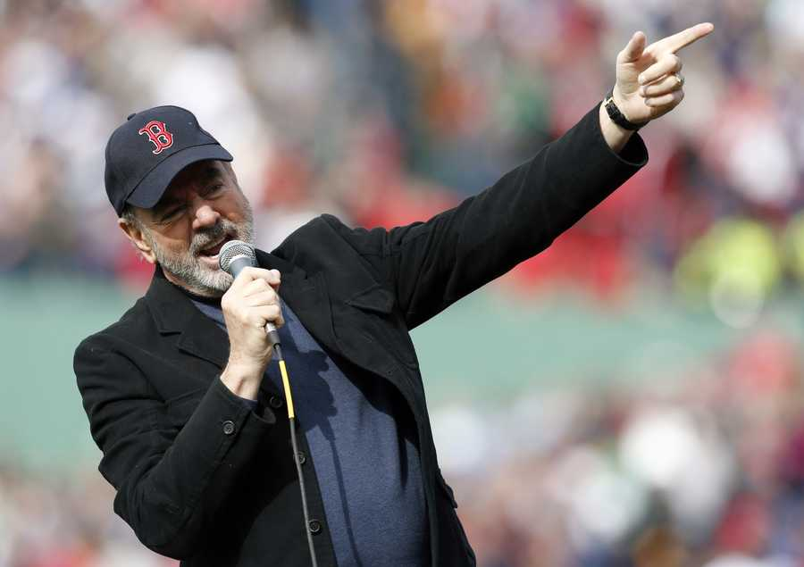 "Neil Diamond sings '""Sweet Caroline"" during the eighth inning of a baseball game between the Boston Red Sox and the Kansas City Royals in Boston, April 20, 2013."