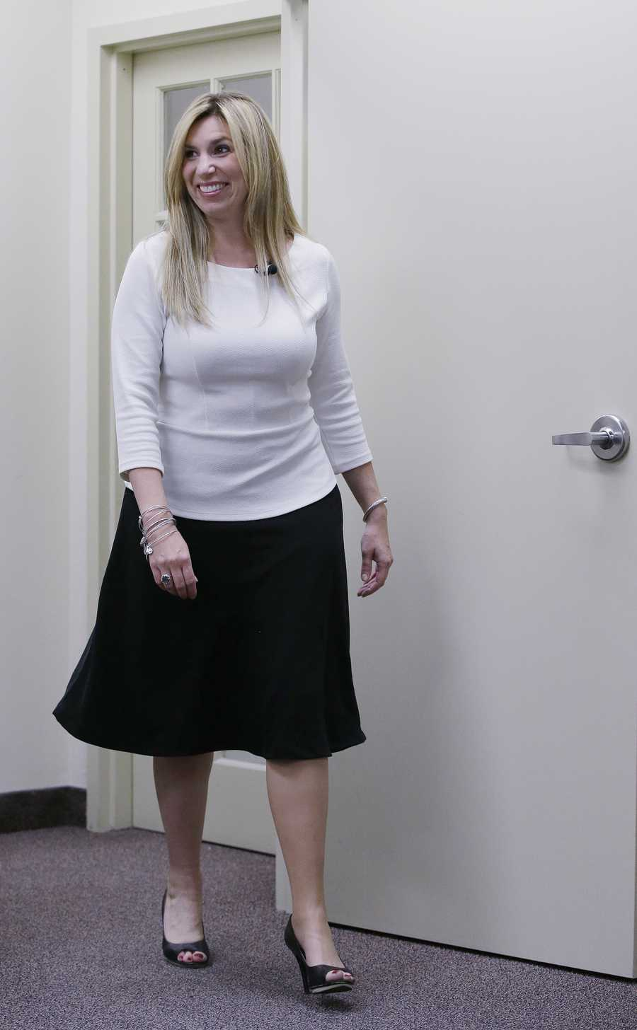 """Sporting her 4-inch Nine West high heels Heather Abbott of Newport, RI., shows off her new """"high-definition"""" prosthetic leg which allows her to also wear heels and skirts in Warwick, R.I.,, Nov. 7, 2013. Abbott lost her left leg in the April 15, 2013 Boston Marathon bombings."""